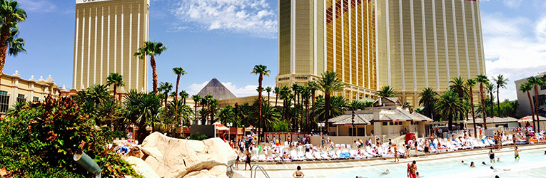 The pool complex is surrounded by tropical palm trees, waterfalls and fountains. The venue has a total of eight pools, including the real sand beach, wave pool, and traditional pools. Mandalay Bay Beach. Mandalay Bay offers a world-famous aquatic playground in the heart of Las Vegas.